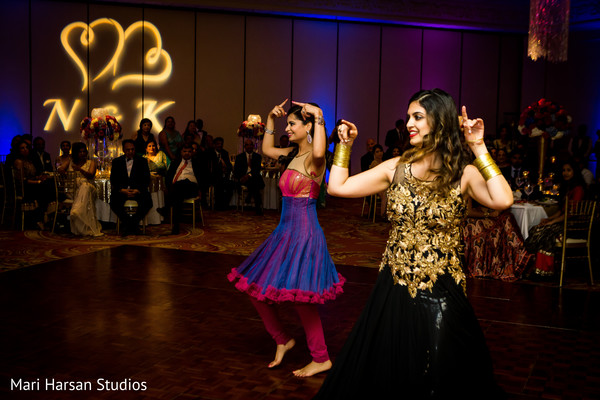 Family dancing and performing at the wedding reception. in Southhampton, Bermuda Indian Wedding by Mari Harsan Studios