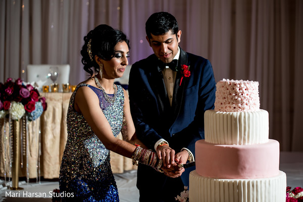 Indian wedding cake cutting. in Southhampton, Bermuda Indian Wedding by Mari Harsan Studios