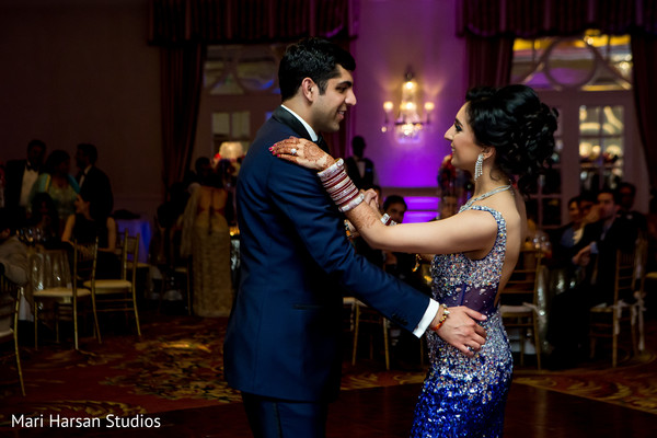 Indian bride and groom dancing in their wedding reception. in Southhampton, Bermuda Indian Wedding by Mari Harsan Studios