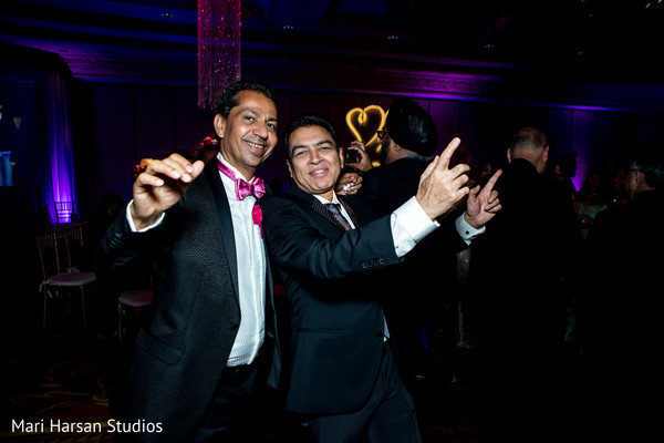 Indian wedding guests having fun during the reception. in Southhampton, Bermuda Indian Wedding by Mari Harsan Studios