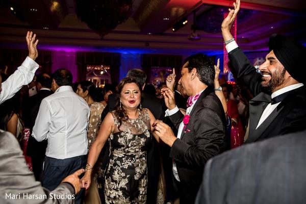 Indian wedding reception guests. in Southhampton, Bermuda Indian Wedding by Mari Harsan Studios