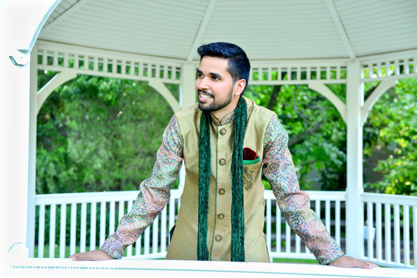 Indian groom wearing a beautiful green sherwani. in Edison, NJ Indian Wedding by House of Talent Studio
