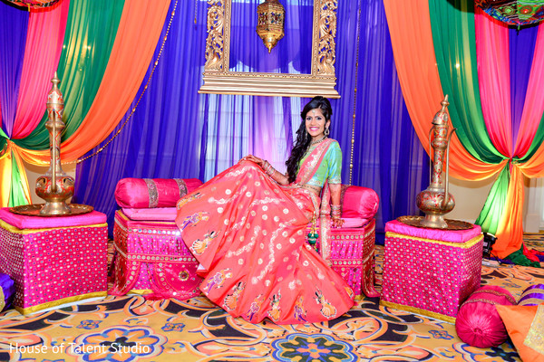 Lovely bride to be wearing an orange and light blue lengha. in Edison, NJ Indian Wedding by House of Talent Studio