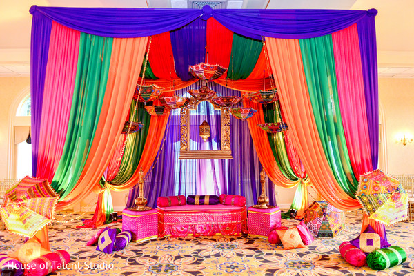 Beautiful colorful draped garba stage. in Edison, NJ Indian Wedding by House of Talent Studio