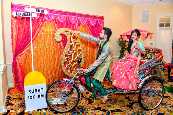 Indian bride and groom entering into their garba in a rickshaw. in Edison, NJ Indian Wedding by House of Talent Studio