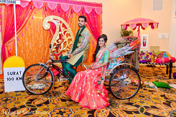 Indian bride and groom posing in lovely colorful rickshaw. in Edison, NJ Indian Wedding by House of Talent Studio
