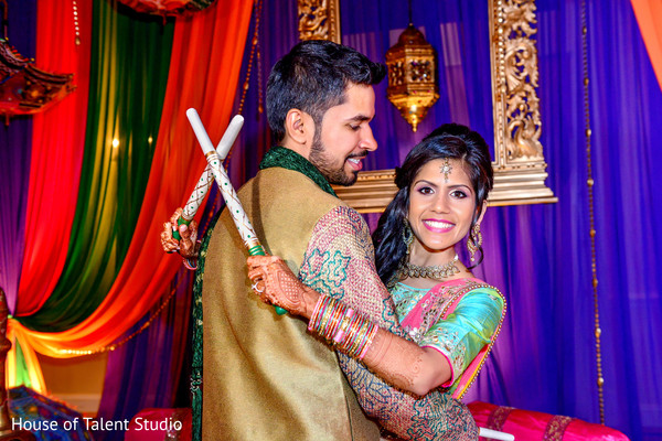See this colorful indian couple during their garba celebration. in Edison, NJ Indian Wedding by House of Talent Studio