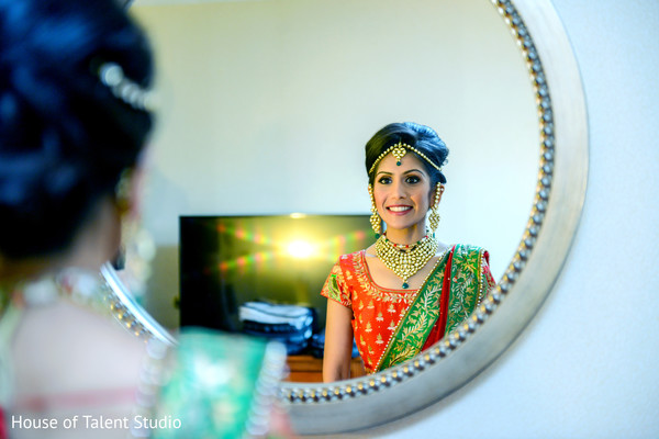 Stunning indian taking a last look to her hair and make up. in Edison, NJ Indian Wedding by House of Talent Studio