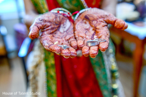 Indian wedding rings in hands of the bride. in Edison, NJ Indian Wedding by House of Talent Studio