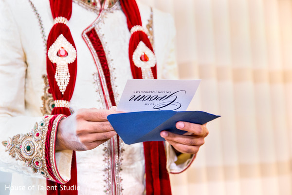Indian groom reading a letter from his bride before the ceremony. in Edison, NJ Indian Wedding by House of Talent Studio