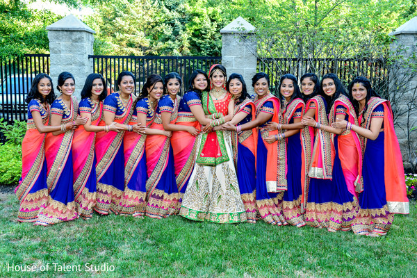 Cute image of indian bride with her bridesmaids in lovely blue and orange sarees. in Edison, NJ Indian Wedding by House of Talent Studio