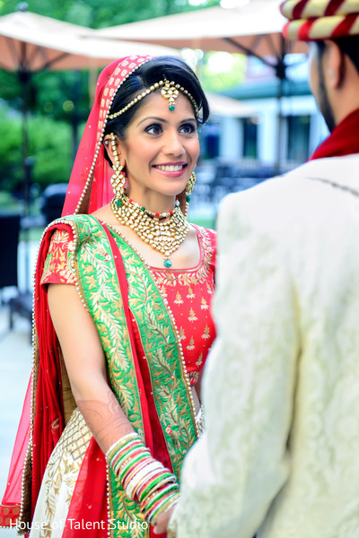 Beautiful indian bride first look reaction. in Edison, NJ Indian Wedding by House of Talent Studio