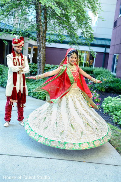 Indian bride showing her beautiful lengha. in Edison, NJ Indian Wedding by House of Talent Studio