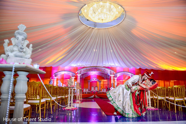 Stunning bride and groom at their wedding ceremony venue. in Edison, NJ Indian Wedding by House of Talent Studio