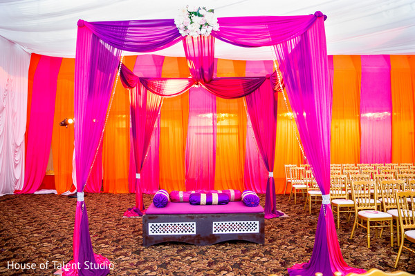Lovely pink and purple wedding ceremony lateral stage. in Edison, NJ Indian Wedding by House of Talent Studio