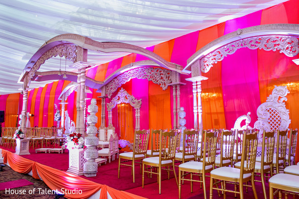 Stunning view of  orange and pink mandap. in Edison, NJ Indian Wedding by House of Talent Studio
