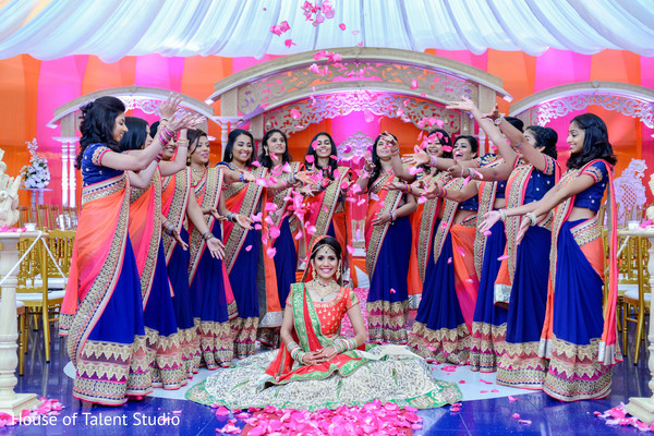 Fabulous shot of indian bridesmaids throwing rose petals to the bride in Edison, NJ Indian Wedding by House of Talent Studio
