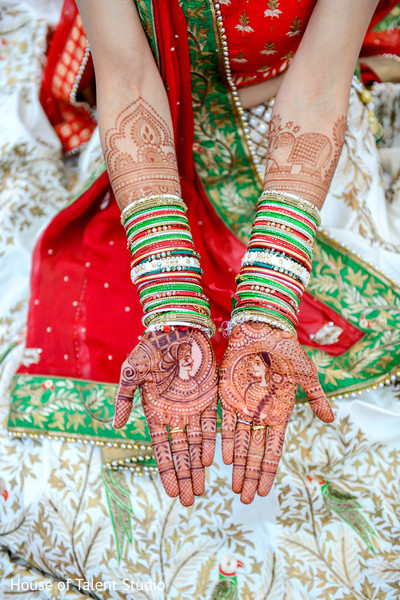 Bridal mehndi and red gold and green bangles. in Edison, NJ Indian Wedding by House of Talent Studio
