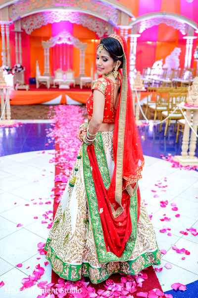 Indian bride posing in her beautiful red, green and white lengha. in Edison, NJ Indian Wedding by House of Talent Studio