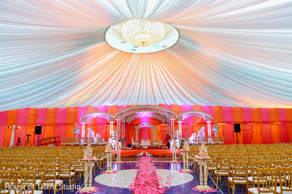 Amazing view of indian ceremony draped stage and ceiling decoration. in Edison, NJ Indian Wedding by House of Talent Studio