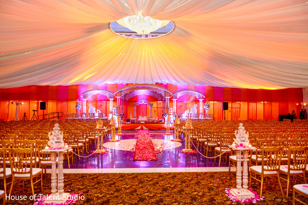 Amazing view of indian ceremony mandap stage decoration and lightning. in Edison, NJ Indian Wedding by House of Talent Studio