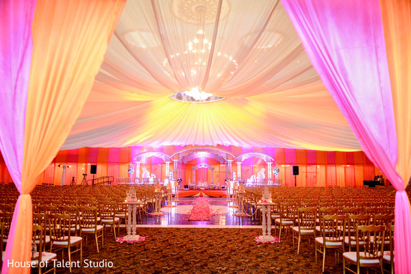 Impressive view of the wedding ceremony aisle and mandap stage. in Edison, NJ Indian Wedding by House of Talent Studio
