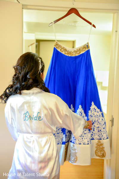 Lovely bride admiring her blue and silver lengha. in Edison, NJ Indian Wedding by House of Talent Studio