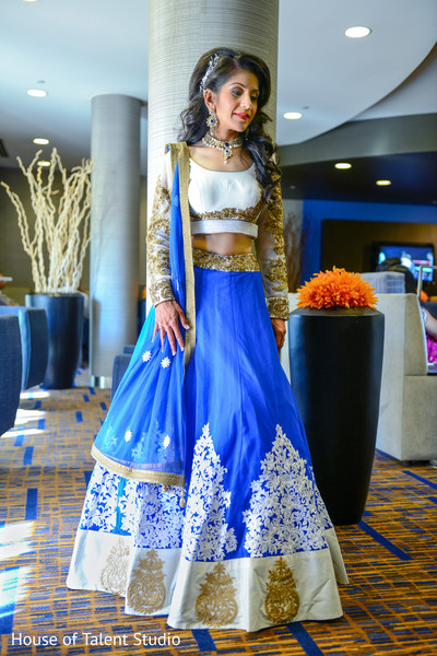 Glamorous indian bride in blue, white and gold lengha. in Edison, NJ Indian Wedding by House of Talent Studio