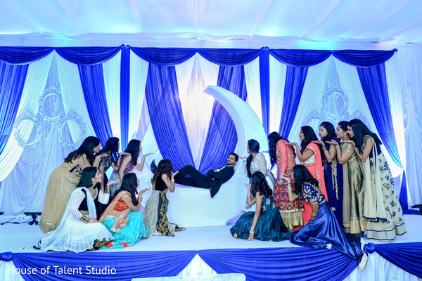 Lovely image of indian bridesmaids throwing kisses to the groom. in Edison, NJ Indian Wedding by House of Talent Studio
