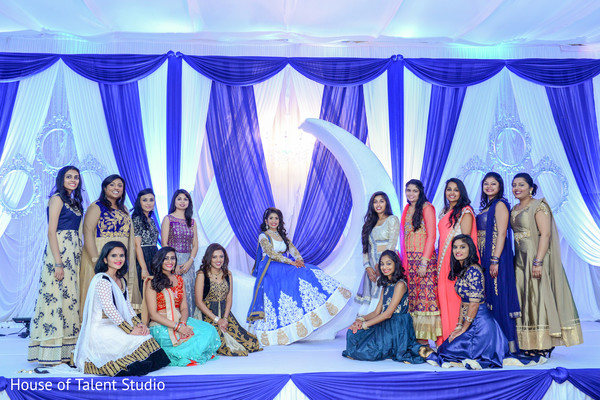 Indian bridesmaids posing with the beautiful bride in the main reception stage. in Edison, NJ Indian Wedding by House of Talent Studio