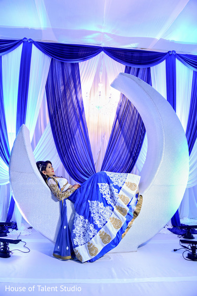 Fantastic shot of indian bride posing in a beautiful white moon. in Edison, NJ Indian Wedding by House of Talent Studio