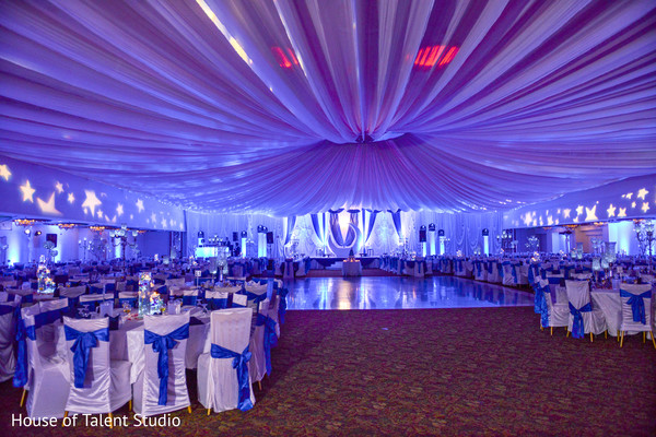 Blue and white decoration of indian wedding reception venue. in Edison, NJ Indian Wedding by House of Talent Studio