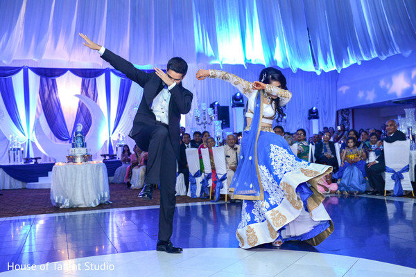 Fantastic shot of indian bride and groom choreography. in Edison, NJ Indian Wedding by House of Talent Studio