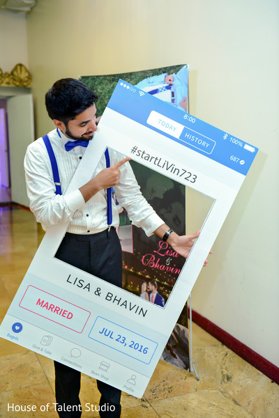 Indian groom with cute photo booth frame. in Edison, NJ Indian Wedding by House of Talent Studio