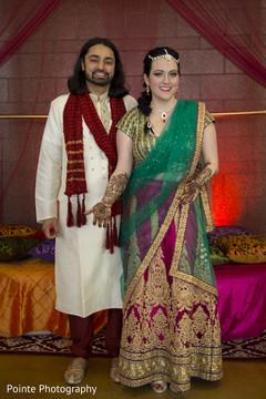 indian couple,mehndi party,mehndi designs