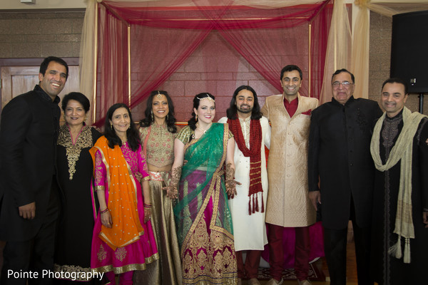 Family during mehndi party in Detroit, Michigan Fusion Wedding by Pointe Photography