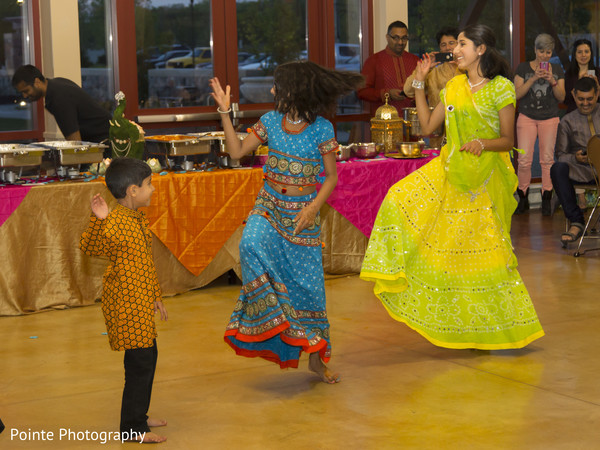 Enjoying mehndi party in Detroit, Michigan Fusion Wedding by Pointe Photography