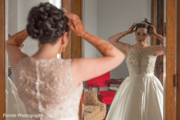 Beautiful bride getting ready for wedding ceremony in Detroit, Michigan Fusion Wedding by Pointe Photography