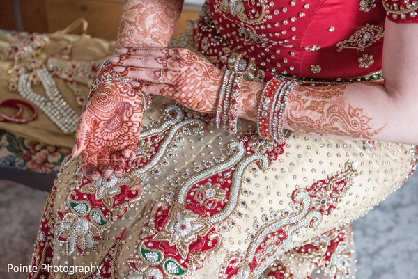 Maharani getting her bridal jewerly in Detroit, Michigan Fusion Wedding by Pointe Photography