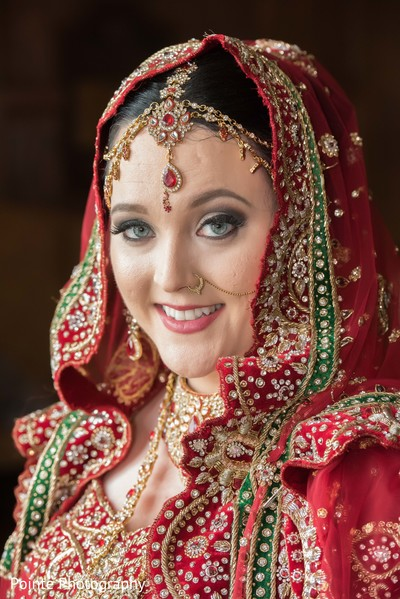 Lovely maharani in red sari in Detroit, Michigan Fusion Wedding by Pointe Photography