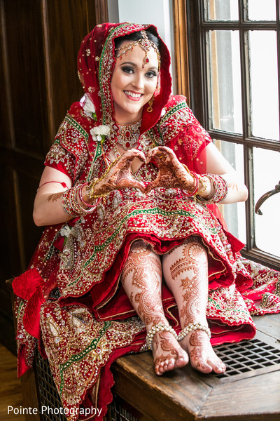 Maharani in lovely red sari in Detroit, Michigan Fusion Wedding by Pointe Photography