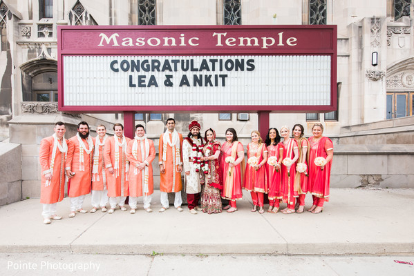 Indian couple posing with their bridesmaids and goomsmen in Detroit, Michigan Fusion Wedding by Pointe Photography