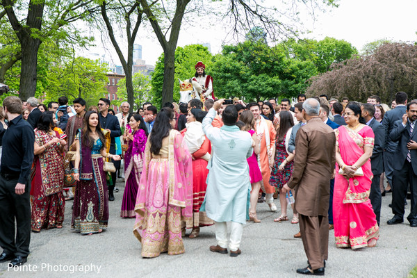 Indian groom making his entrance during Baraat in Detroit, Michigan Fusion Wedding by Pointe Photography