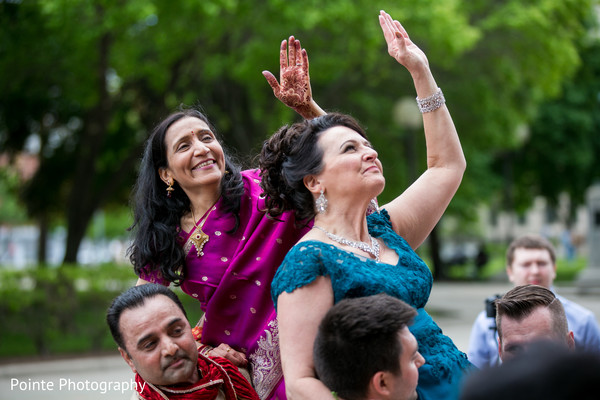 Family having fun during baraat in Detroit, Michigan Fusion Wedding by Pointe Photography