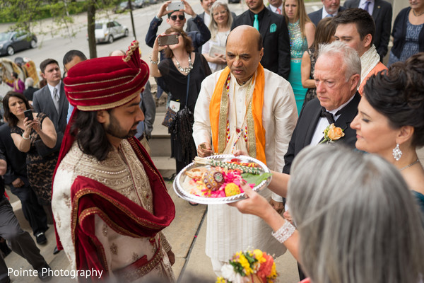 Indian groom during baraat in Detroit, Michigan Fusion Wedding by Pointe Photography