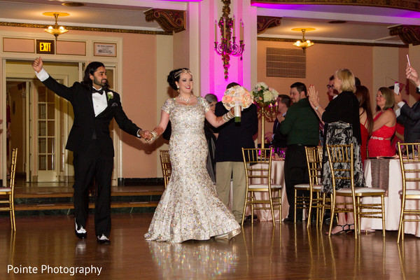 Lovely couple making their entrance to reception in Detroit, Michigan Fusion Wedding by Pointe Photography