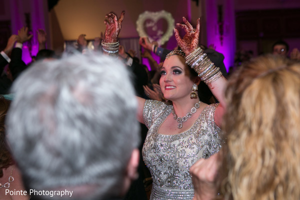 Lovely maharani having fun in their wedding reception in Detroit, Michigan Fusion Wedding by Pointe Photography