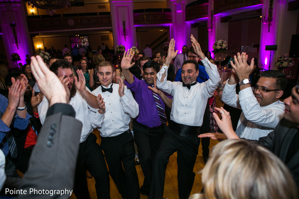 Getting the party started at this Indian wedding reception in Detroit, Michigan Fusion Wedding by Pointe Photography