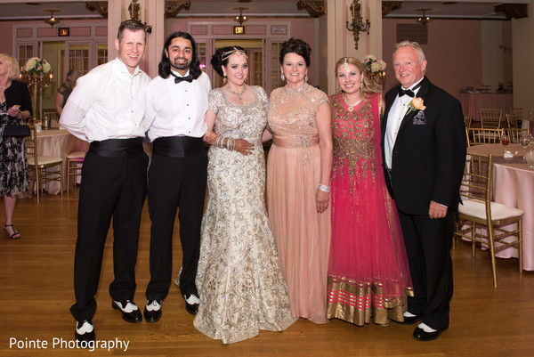 Lovely couple with family during wedding reception in Detroit, Michigan Fusion Wedding by Pointe Photography