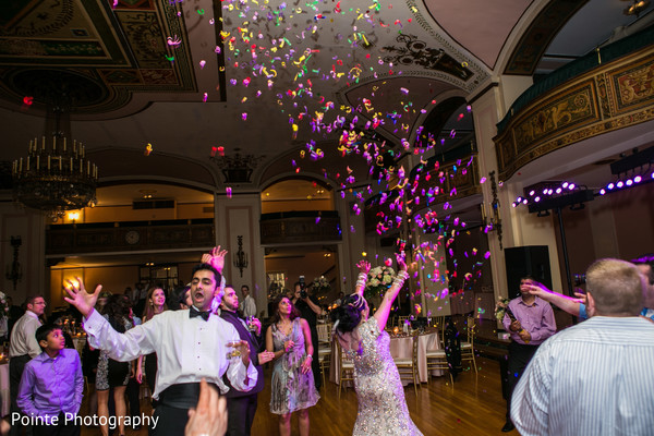 Maharani having fun in the dance floor in Detroit, Michigan Fusion Wedding by Pointe Photography